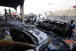 SANAA, Oct. 8, 2016 (Xinhua) -- A man stands by destroyed cars at a funeral hall after it was targeted by airstrikes in Sanaa, Yemen, on Oct. 8, 2016. The Saudi-led coalition airstrikes on a funeral hall in Yemen's capital Sanaa on Saturday have killed 82 and injured 534, acting health minister Ghazi Ismail told reporters in a press conference on Saturday night. (Xinhua/Mohammed Mohammed) (Credit Image: © Mohammed Mohammed/Xinhua via ZUMA Wire)