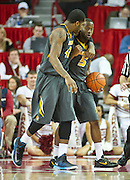 Feb 16, 2013; Fayetteville, AR, USA; Missouri Tigers forward Alex Oriakhi (42) and guard Keion Bell (5) react to a play during a game against the Arkansas Razorbacks at Bud Walton Arena. Arkansas defeated Missouri 73-71. Mandatory Credit: Beth Hall-USA TODAY Sports