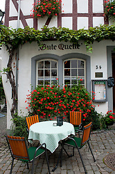 Cafe on street in square  in Beilstein village on River Mosel in Rhineland-Palatinate Germany