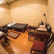 The bedroom and office of Norman Brook, the Deputy Secretary to the War Cabinet, at the Churchill War Rooms in London. The museum, one of five branches of the Imerial War Museums, preserves the World War II underground command bunker used by British Prime Minister Winston Churchill. Its cramped quarters were constructed from a converting a storage basement in the Treasury Building in Whitehall, London. Being underground, and under an unusually sturdy building, the Cabinet War Rooms were afforded some protection from the bombs falling above during the Blitz.