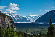 Matanuska Glacier (in 2019), source of the Matanuska River in Alaska, is the largest glacier accessible by car in the United States: 27 miles (43 km) long by 4 miles (6.4 km) wide. It flows near the Glenn Highway in the Chugach Mountains about 100 miles (160 km) northeast of Anchorage. Matanuska Glacier flows about 1 foot (30 cm) per day. The Matanuska Glacier has lost 84 million tons of ice 2002-2019 (www.ksl.com/article/27440688). Human-caused climate change has quickly accelerated the unprecedented warming of Alaska in the past few decades.