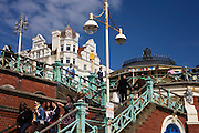Seaside people use steps on Brighton's steps near the West Pier.