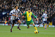 Gary Hooper of Norwich city makes a break which leads to his goal. Barclays Premier league, West Bromwich Albion v Norwich city at the Hawthorns in West Bromwich, England on Sat 7th Dec 2013. pic by Andrew Orchard, Andrew Orchard sports photography.