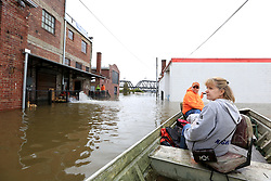 May 2, 2019 - Davenport, Iowa, U.S. - RYAN LINCOLN, left maneuvers his jon boat through flood water while taking volunteer DONNA MAGNUS to the back door of the Dress for Success location on E 2nd St. in downtown Davenport Thursday. (Credit Image: © Kevin E. Schmidt/Quad-City Times via ZUMA Wire)