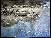 children pushing a rowboat on to the beach Japan ca 1940s