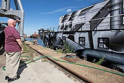 © Licensed to London News Pictures. 06/08/2016. Historic WWI warship HMS President pictured languishing at Chatham Docks today. The HMS President Preservation Trust which looks after her say she is very likely to be scrapped, almost 100 years after the war, after losing out on heritage lottery funding. A fundraising campaign has been launched as well as a petition calling on the Goverment to save the vessel which was a popular fixture on the Victoria Embankment for over 90 years until she was moved away from her berth in February this year to enable works on the Thames Tideway Tunnel super sewer project. Funds are needed to refit the ship and pay for a new mooring in the City. Petition link: https://petition.parliament.uk/petitions/163742 Fundraising link: https://www.justgiving.com/hms-president Press comment available from Paul Williams on 07802 271260.  Credit : Rob Powell/LNP