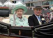 © Licensed to London News Pictures. 21/06/2012. Ascot, UK HRH Queen Elizabeth II and HRH The Duke of Edinburgh arrive at Ladies Day at Royal Ascot 21st June 2012. Royal Ascot has established itself as a national institution and the centrepiece of the British social calendar as well as being a stage for the best racehorses in the world.. Photo credit : Stephen Simpson/LNP