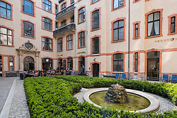 Blue Yard courtyard containing cafes and fashion boutiques and shops in Mitte Berlin Germany