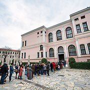 Tourists line up to visit the Harem (privy chambers) of Dolmabahçe Palace. Dolmabahçe Palace, on the banks of the Bosphorus Strait, was the administrative center of the Ottoman Empire from 1856 to 1887 and 1909 to 1922. Built and decorated in the Ottoman Baroque style, it stretches along a section of the European coast of the Bosphorus Strait in central Istanbul.