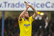 AFC Wimbledon midfielder Anthony Wordsworth (40) clapping is shin pads together during the EFL Sky Bet League 1 match between Southend United and AFC Wimbledon at Roots Hall, Southend, England on 12 October 2019.