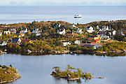 The ferry from Bodo passes the town of Sorvagen on Moskenesoya, Lofoten Islands, Norway.