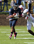Oct. 22, 2011 - Charlottesville, Virginia - USA; Virginia Cavaliers running back Khalek Shepherd (38) is tackled by North Carolina State Wolfpack safety Dontae Johnson (25)  during an NCAA football game at the Scott Stadium. NC State defeated Virginia 28-14. (Credit Image: © Andrew Shurtleff