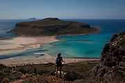 Tourist at Balos Beach, on Gramvousa peninsula, in north western Crete, Greece. The beach is famous for its white sands and turquoise waters and is a protected nature reserve.