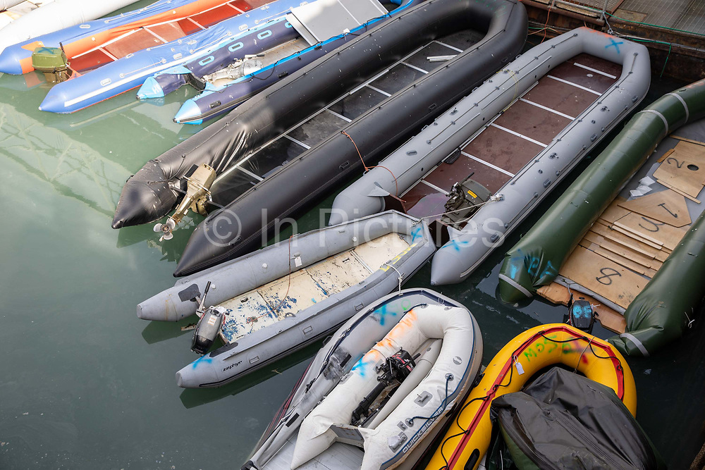 Rigid Inflatable Boats RIBs in Dover docks that have been used by asylum seekers after being  <br /> rescued in the English Channel while crossing in small inflatable dinghy in March 2021 in Dover, Kent, United Kingdom. About 30 men and women arrived today the 31st of March 2021 on two small boats they were taken off the boat by UK Boarder Force and taken into a processing centre on the dock side.