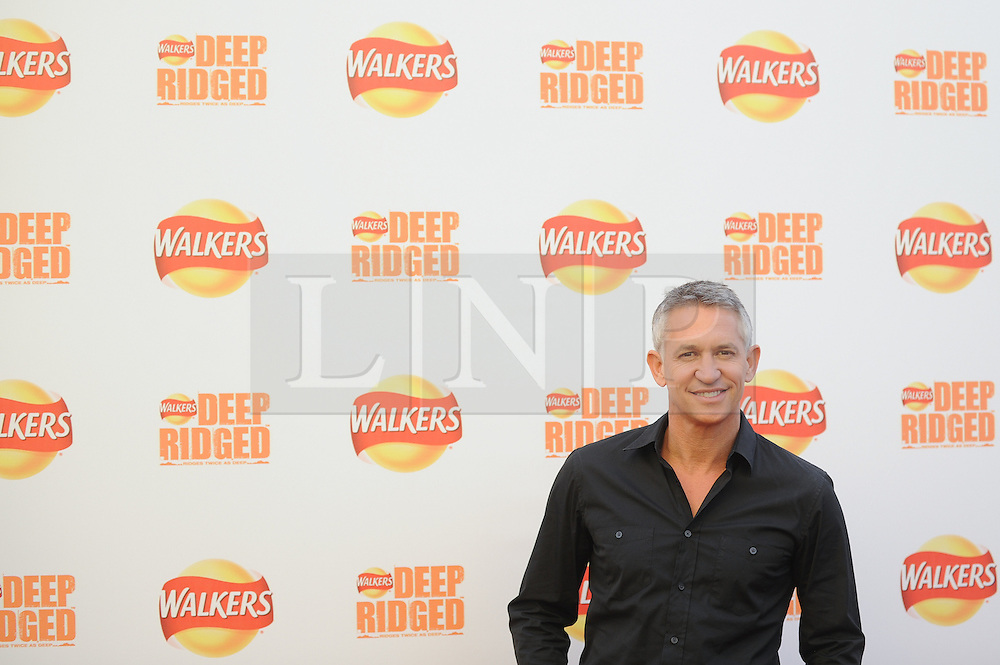 © Licensed to London News Pictures. 29/08/2012. London,UK. Garry LinEker attending the launch Walkers news Deep Ridged crisps. To celebrate the launch Walkers unveiled 'Britain's Biggest Ever Crisp' standing at 22m tall .Photo credit : Thomas Campean/LNP. .