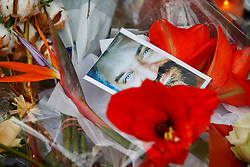 © Licensed to London News Pictures. 17/11/2015. Paris, France. Pictures of victims and flowers left outside La Belle Équipe cafe in Paris, France following the Paris terror attacks on Tuesday, 17 November 2015. Photo credit: Tolga Akmen/LNP