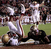 TALLAHASSEE, FL. 11/15/08-FSU-BC CH6-Florida State's Greg Carr, right, lays in the endzone after Boston College's DeLeon Gause intercepted a pass meant for him during fourth quarter action Saturday at Doak Campbell Stadium in Tallahassee.  The Seminoles lost to the Eagles 27-17...COLIN HACKLEY PHOTO