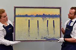 "© Licensed to London News Pictures. 15/06/2017. London, UK. Technicians hang ""L'Éscaut en amont dÁnvers, le soir or Voiliers sur l'escaut"", 1892, by Théo van Rysselberghe (estimate GBP7-10m).  Preview of Impressionist and Modern art sale, which will take place at Sotheby's New Bond Street on 21 June.  Photo credit : Stephen Chung/LNP"