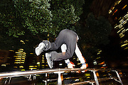 Vaulting over a park rail. Parkour Tokyo group practice, Shinjuku Chuo Koen, Tokyo, Japan, January 10, 2012. Parkour is a modern method of physical training, also known as freerunning. It was founded in France in the 1990s. There is a small group of around 50 parkour practitioners in Tokyo.