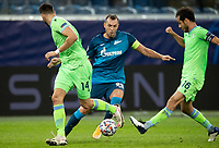 SAINT PETERSBURG, RUSSIA - NOVEMBER 04: Artem Dzyuba of Zenit St Petersburg takes on Wesley Hoedt and Marco Parolo of SS Lazio during the UEFA Champions League Group F stage match between Zenit St. Petersburg and SS Lazio at Gazprom Arena on November 4, 2020 in Saint Petersburg, Russia. (Photo by MB Media)