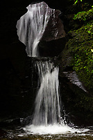 Saint Nectan's Glen is a area of woodland in Trethevy near Tintagel, north Cornwall stretching for about  one mile along both banks of the Trevillet River. The  most prominent feature is St Nectan's Kieve, asixty foot waterfall through a hole in the rocks.photo by Mark Anton Smith