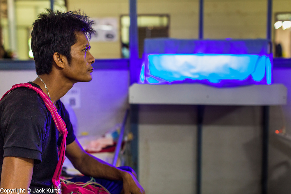 20 MAY 2013 - MAE KASA, TAK, THAILAND:  A Burmese man sits with his baby, who is in an incubator, at the SMRU clinic in Mae Kasa, Thailand. Health professionals are seeing increasing evidence of malaria resistant to artemisinin coming out of the jungles of Southeast Asia. Artemisinin has been the first choice for battling malaria in Southeast Asia for 20 years. In recent years though,  health care workers in Cambodia and Myanmar (Burma) are seeing signs that the malaria parasite is becoming resistant to artemisinin. Scientists who study malaria are concerned that history could repeat itself because chloroquine, an effective malaria treatment until the 1990s, first lost its effectiveness in Cambodia and Burma before spreading to Africa, which led to a spike in deaths there. Doctors at the Shaklo Malaria Research Unit (SMRU), which studies malaria along the Thai Burma border, are worried that artemisinin resistance is growing at a rapid pace. Dr. Aung Pyae Phyo, a Burmese physician at a SMRU clinic just a few meters from the Burmese border, said that in 2009, 90 percent of patients were cured with artemisinin, but in 2010, it dropped to about 70 percent and is now between 55 and 60 percent. He said the concern is that as it becomes more difficult to clear the parasite from a patient, progress that has been made in combating malaria will be lost and the disease could make a comeback in Southeast Asia.    PHOTO BY JACK KURTZ