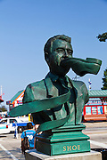 Shoe - Bronze statue of a man with a shoe in his mouth at the entrance to Navy Pier, Chicago, IL, USA