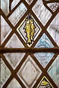 Church of Saint Andrew, Little Glemham, detail of stained glass window two fishes by Margaret Edith Aldrich Rope 1929