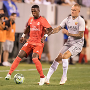 MEADOWLANDS, NEW JERSEY- August 7:   Vinícius Júnior #28 of Real Madrid is challenged by Rick Karsdorp #2 of AS Roma during the Real Madrid vs AS Roma International Champions Cup match at MetLife Stadium on August 7, 2018 in Meadowlands, New Jersey. (Photo by Tim Clayton/Corbis via Getty Images)