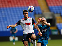 Football - 2020 / 2021 Sky Beat League Two - Bolton Wanderers vs Grimsby Town<br /> <br /> Ryan Delaney of Bolton Wanderers wins his challenge against James Morton of Grimsby Town, at University of Bolton Stadium.<br /> <br /> COLORSPORT/ALAN MARTIN