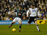 Photo: Leigh Quinnell.<br /> Derby County v Plymouth Argyle. Coca Cola Championship. 30/12/2006. Plymouths David Norris holds off Derbys Matt Oakley.
