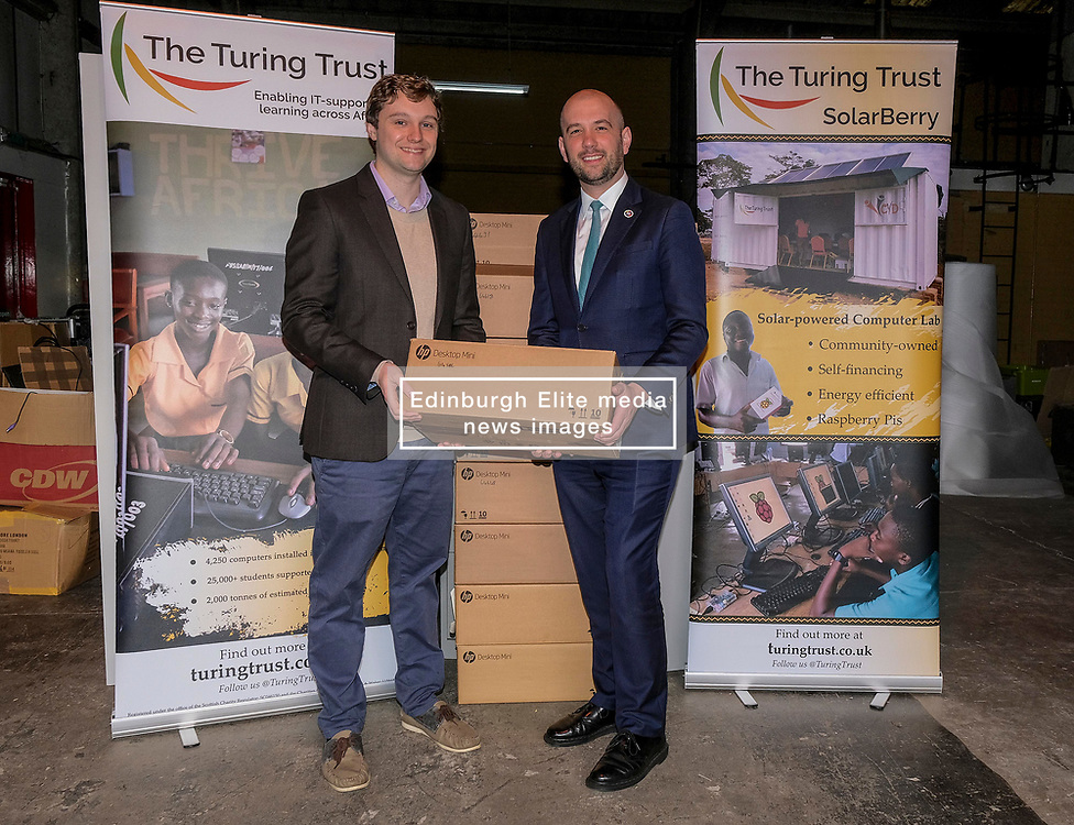 ** PLEASE  NOTE: story embargoed for Saturday 18 January **<br /> <br /> Scottish Government donate used computers to Africa, Thursday 16th January 2020<br /> <br /> Trainee  teachers and students in Africa are to receive 1,000 used Scottish Government  computers thanks to a partnership with The Turing Trust.<br /> <br /> International  Development Minister Ben Macpherson visited the charity's warehouse and met James Turing,  co-founder of The Turing Trust and great nephew of WWII codebreaker Alan  Turing<br /> <br /> Pictured: Ben Macpherson MSP (right) is shown round the warehouse by Turing Trust founder James Turing<br /> <br /> Alex Todd | Edinburgh Elite media