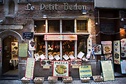 Signs for an international menu outside Le Petit Bedon restaurant in Brussels, Belgium. The Brussels-Capital Region is a region of Belgium comprising 19 municipalities, including the City of Brussels.
