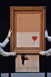 © Licensed to London News Pictures. 12/10/2018. London, UK. Banksy's Surprise Intervention into Sotheby's Contemporary Art Evening Sale on 5 October will be on display to the public.  Sotheby's will display the Newly Completed Work, Titled 'Love is in the Bin', in London this weekend. Photo credit: Ray Tang/LNP