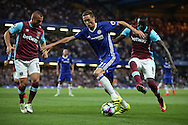Nemanja Matic of Chelsea in action with Gokhan Tore of West Ham United and Cheikhou Kouyate of West Ham United (r) marking. Premier league match, Chelsea v West Ham United at Stamford Bridge in London on Monday 15th August 2016.<br /> pic by John Patrick Fletcher, Andrew Orchard sports photography.
