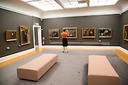 Gallery interior inside with framed paintings mounted on wall, Kode 3 art gallery Bergen, Norway