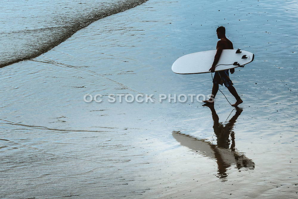 Surfer Heading into the Water