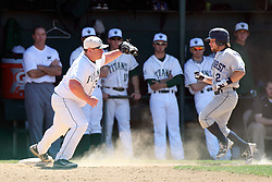 14 April 2013:  Kevin Callahan scoops a ball from the dust for an out at first during an NCAA division 3 College Conference of Illinois and Wisconsin (CCIW) Baseball game between the Elmhurst Bluejays and the Illinois Wesleyan Titans in Jack Horenberger Stadium, Bloomington IL