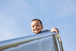 Playground small boy high up portrait slide metal