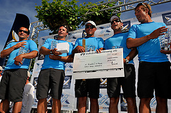 Bruni and his team collect their spoils after winning Match Race Germany. Photo: Chris Davies/WMRT