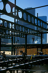 Stock photo of construction workers walking on steel beams at the construction site of a new building near downtown Houston Texas