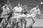 Twickenham. Great Britain.  <br /> Scrum-Half, Steve BATES, passes the ball out. left Paul ACKFORD, Centre Mickey SKINNER and right Dean RYAN, 15.20.1988. London And South East Division vs Australia The Old Twickenham Stadium [The start of the new Stadium started soon after this game]  [Mandatory Credit, Peter Spurrier/Intersport Images].