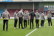 Burton Albion players on the pitch prior to kick off during the The FA Cup 1st round match between Scunthorpe United and Burton Albion at Glanford Park, Scunthorpe, England on 10 November 2018.