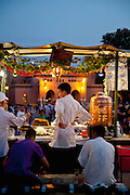 A busy food stall in the Djemaa el Fna in the medina of Marrakech, Morocco. Every night the main square fills with dozens of food vendors and their carts.