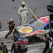 The pit crew of NASCAR Sprint Cup driver Austin Dillon (3) work during the 56th Annual NASCAR Coke Zero 400 race at Daytona International Speedway on Sunday, July 6, 2014 in Daytona Beach, Florida.  (AP Photo/Alex Menendez)