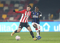 Brentford's Halil Dervisoglu and Middlesbrough's Marc Bola<br /> <br /> Photographer Rob Newell/CameraSport<br /> <br /> The Emirates FA Cup Third Round - Brentford v Middlesbrough - Saturday 9th January 2021 - Brentford Community Stadium - Brentford<br />  <br /> World Copyright © 2021 CameraSport. All rights reserved. 43 Linden Ave. Countesthorpe. Leicester. England. LE8 5PG - Tel: +44 (0) 116 277 4147 - admin@camerasport.com - www.camerasport.com