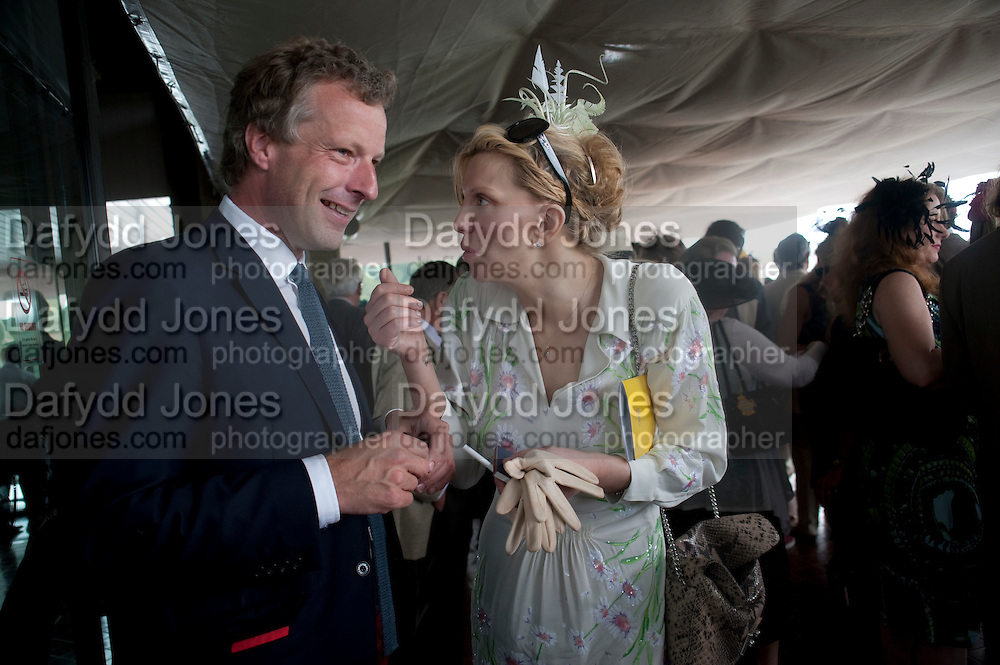 COURTNEY LOVE; HUGO BURNAND IN THE DUKE OF RICHMOND BOX, Glorious Goodwood. Ladies Day. 28 July 2011. <br /> <br />  , -DO NOT ARCHIVE-© Copyright Photograph by Dafydd Jones. 248 Clapham Rd. London SW9 0PZ. Tel 0207 820 0771. www.dafjones.com.