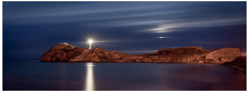 Moonrise over Castlepoint Lighthouse, Wairarapa.