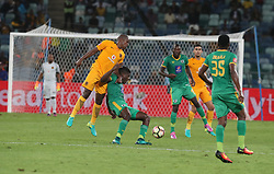 Willard Katsande of Kaizer Chiefs jumps into the back of Nyasha Munetsi of Baroka FC during the 2016 Premier Soccer League match between Kaizer Chiefs and Baroka FC held at the Moses Mabhida Stadium in Durban, South Africa on the 2nd November 2016<br /> <br /> Photo by:   Steve Haag / Real Time Images