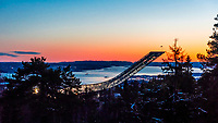 The world famous Holmenkollbakken ski jump, Oslo, Norway with the Oslo Fjord in the background. It has been a site for ski jumping since 1892. Between 2009 and 2010 the entire structure was demolished and rebuilt. It has been the site of numerous world championships and FIS Ski Jumping World Cup Events and was used in 1952 Winter Olympics.